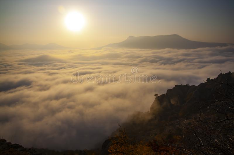 Top of a mountain above the clouds. Freedom before gravity. Beautiful sunset royalty free stock photos