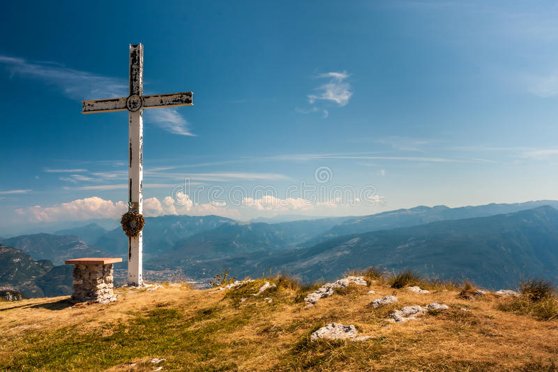 On the top of the mountain. A cross on the top of the mountain at 1647 m on dolomites stock images