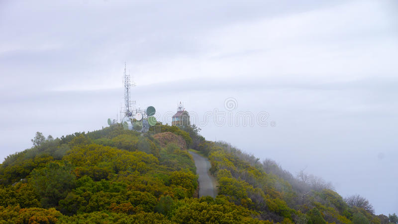 Top of the mountain. This is a picture looking at the top of the mountain with radio station stock photography