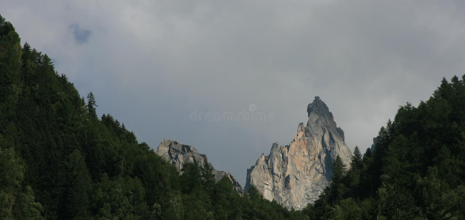Top mountain in trees royalty free stock photo