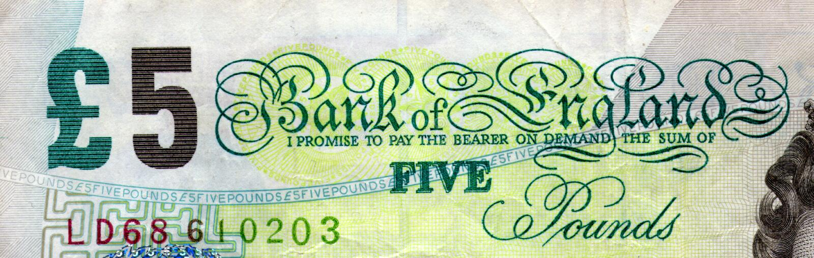 Top of £5 note. The top corner of an English £5 note royalty free stock photography