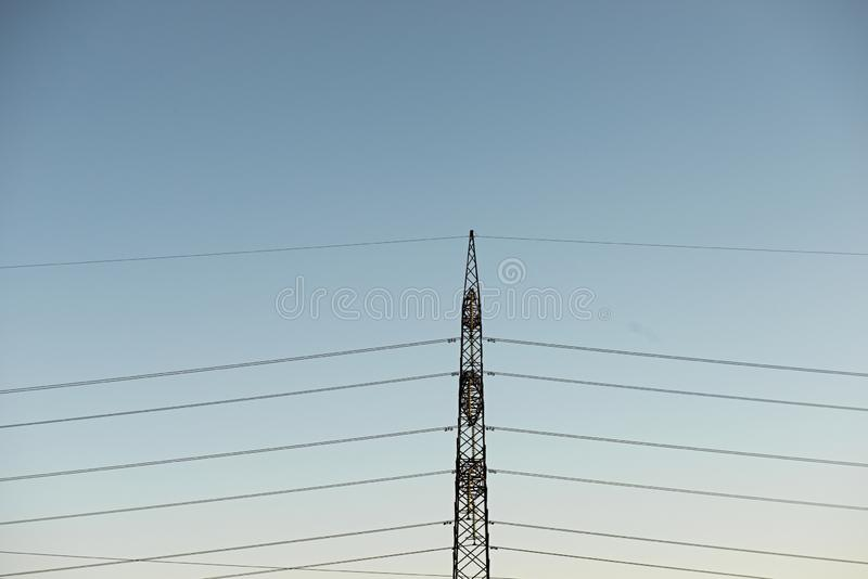 Top old electrical pillar on a background of the blue sky stock photos