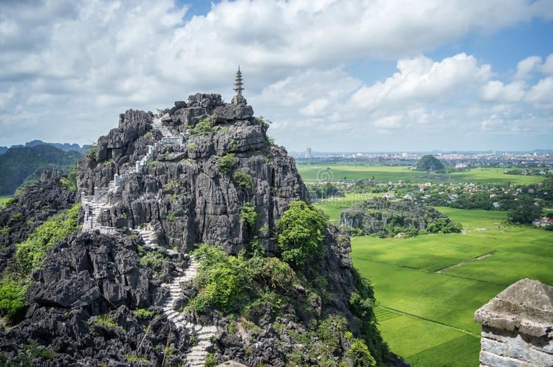 Top pagoda of Hang Mua temple, rice fields, Ninh Binh Vietnam. Top pagoda of Hang Mua temple, rice fields, Ninh Binh, Vietnam stock photography