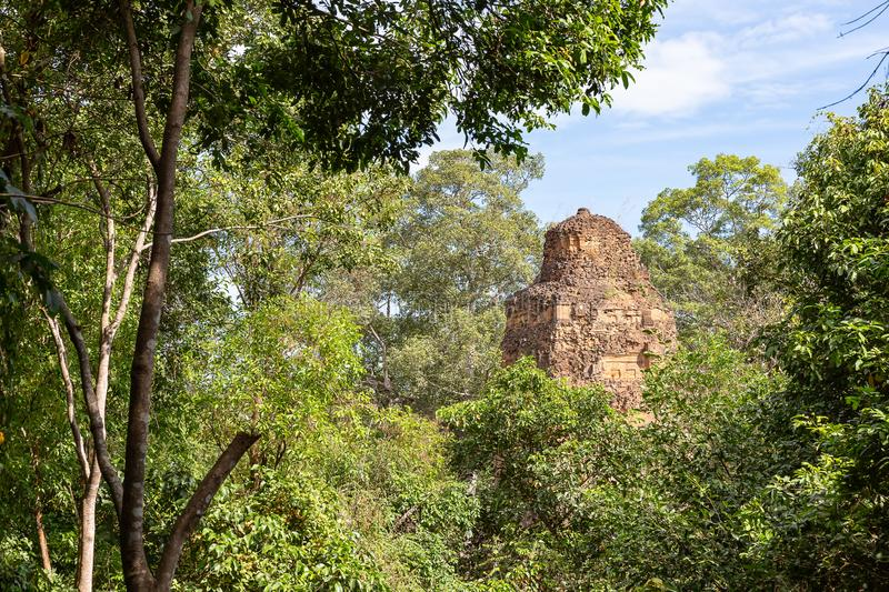 Top of the pancharam tower of Baksei Chamkrong Temple seen from Phnom Bakheng Temple, Angkor, Siem Reap, Cambodia, Asia stock photography