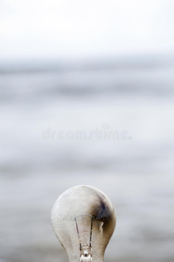 Download Burnt Light Bulb & Bokeh Beach Stock Image - Image: 30073725
