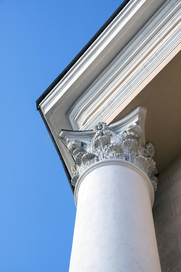 The top part of column decorated with fretwork. The top part of white classical column decorated with fretwork stock images