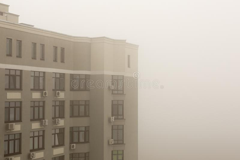 Delightful Download Top Part Of Highrise Modern Apartment Building Facade During Heavy  Fog Weather Stock Image