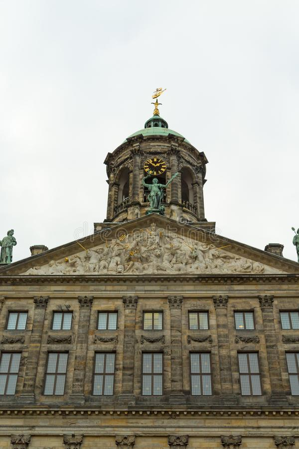 Top part of The Royal Palace in Dam Square, Amsterdam, Netherlands. Vertical stock images