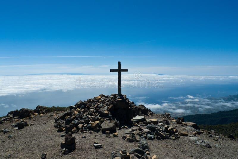 Top of Pico de la Nieve mountain, La Palma island. Cross at top of Pico de la Nieve mountain, La Palma island, Spain, Atlantic ocean royalty free stock image