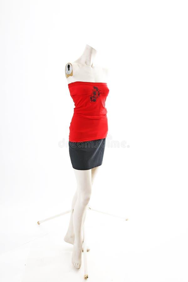 Top rojo con la falda negra en la exhibición completa del body shop del maniquí Estilos de la moda de la mujer, ropa en el fondo  imágenes de archivo libres de regalías