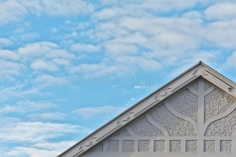 Top roof line shapes and patterns of a art deco residential home. The top roof line shapes and patterns of a art deco residential home contrast with the soft stock photos