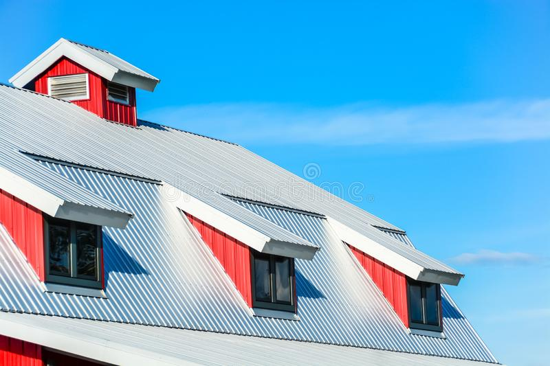 Top roof of red barn on blue sky background stock photo