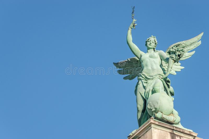 Top roof statue of sensual renaissance era angel with wings in f stock image