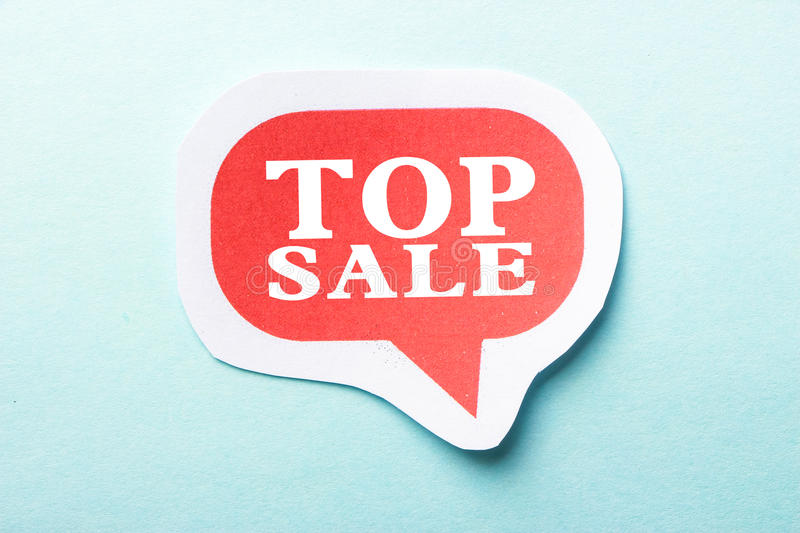 Top Sale. Speech bubble is isolated on the blue background stock photography