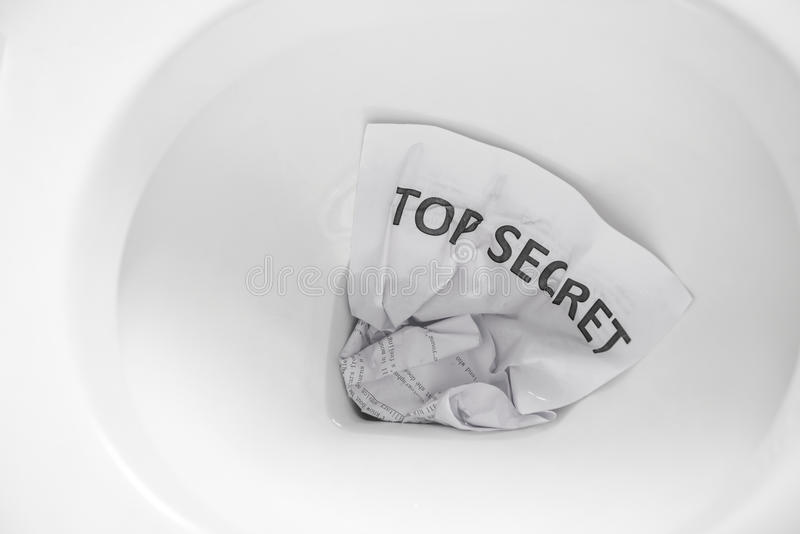 Top secret flush away. Top secret document flush away stock photo