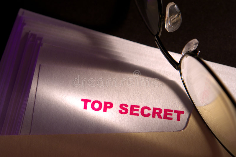 Top Secret Report Document and Glasses in a Folder stock photo