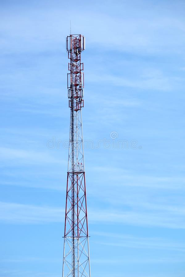 Top section of high communication tower with antennas on the top vertical view. Top section of high communication tower with antennas on the top vertical photo royalty free stock images