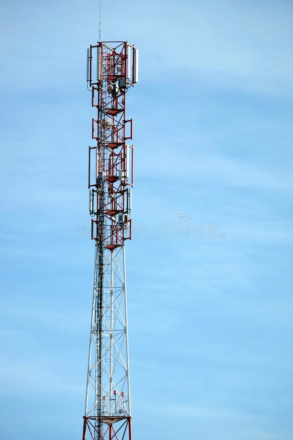 Top section of high communication tower with antennas on the top vertical view. Top section of high communication tower with antennas on the top vertical photo stock images