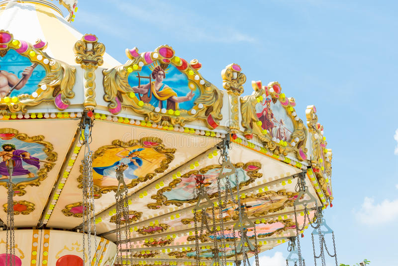 Top section of marry go round amusement park ride. With clear blue sky stock images