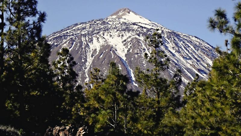 The top snow-capped peak of the highest mountain of Spain the volcano El Teide on the Canary Island Tenerife in closeup royalty free stock photo