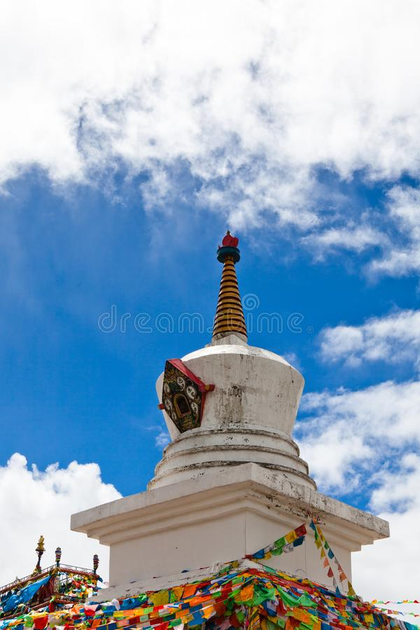 Tibet old pagoda with prayer flags royalty free stock photo