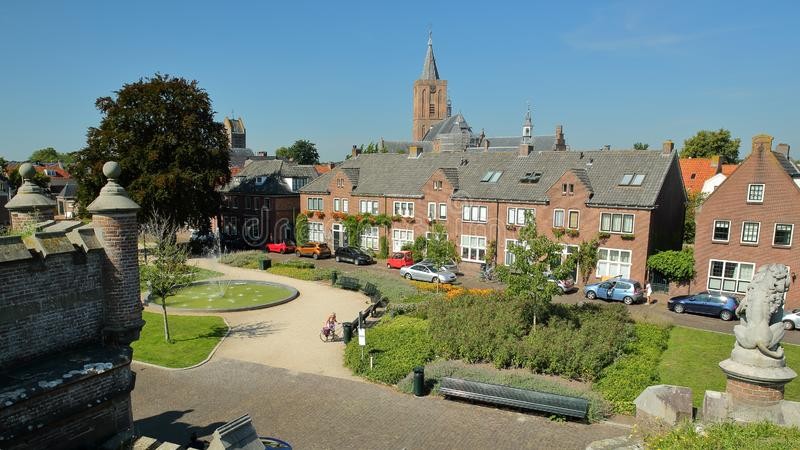 The top of Utrecht gate Utrechtse Poort in the fortified town of Naarden, Netherlands, overlooking Ruijsdaelplein square. And with the clock tower of the Grote stock photography