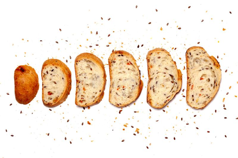 Top view from above composition of set sliced homemade wheat grain fresh gluten free bread, crumbs decorated flax seed, space for royalty free stock images