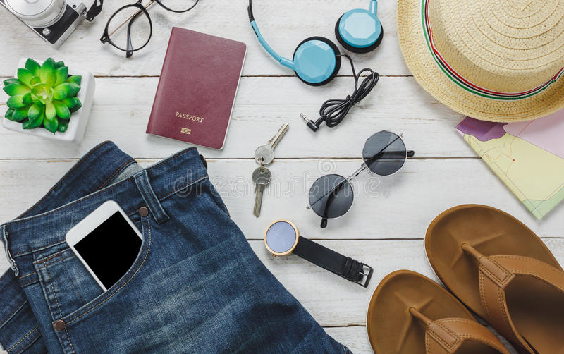 Top view accessoires to travel concept. fd. Top view accessoires to travel concept. mobile phone listening music by headphone on wooden background.shoes,passport royalty free stock photos