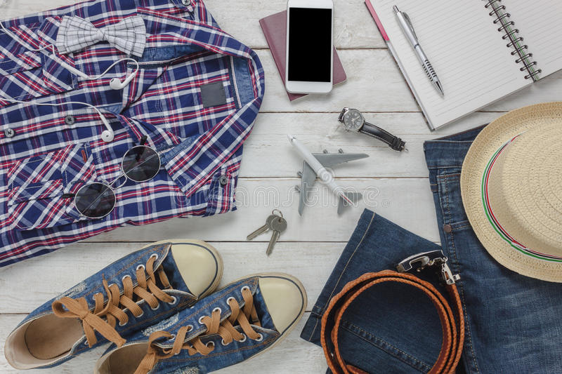 Top view accessoires to travel with man clothing. Top view accessoires to travel with man clothing concept.the essential shirt,jean,mobile phone ,headphone on royalty free stock photos