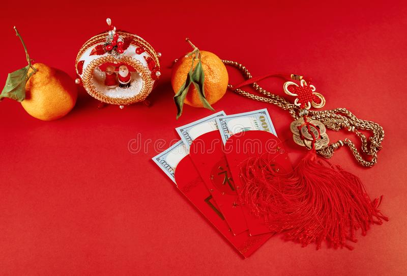 Top view accessories Chinese new year festival decorations of tangerines leaf red packet and dollar money royalty free stock photo