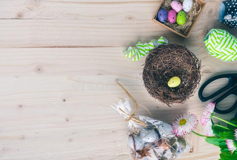 Top view of accessories for making an colorful Easter eggs nest, flat lay stock photo