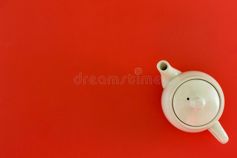 Top view accessories tea pot and red for Chinese new year festival decorations on red background stock photo