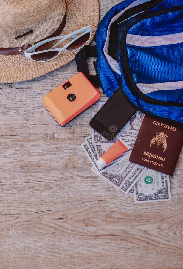 Top view accessories for travel on old wood, stock photo