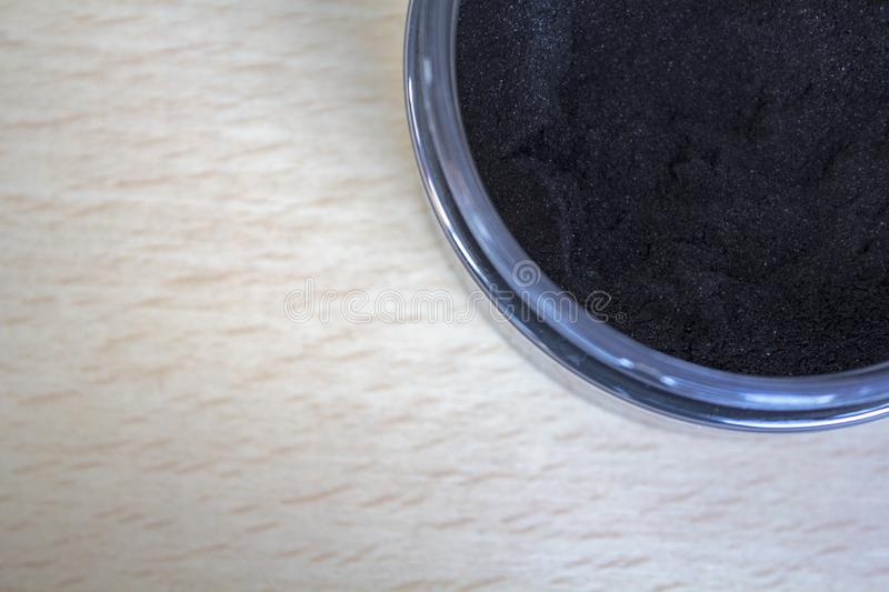 Top view of Activated charcoal powder on jar. With copy space royalty free stock photo