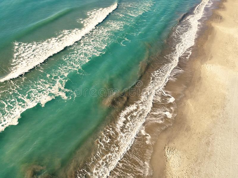 Top view aerial of an amazingly beautiful sea landscape with turquoise water with copy space. Top view aerial of an amazingly beautiful seascape with turquoise royalty free stock photo