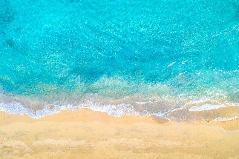 Top view aerial drone photo of ocean seashore with beautiful turquoise water and sea waves. Caribbean resort. Vacation travel royalty free stock images