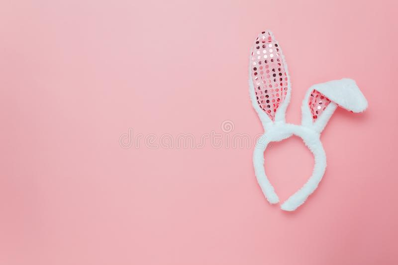 Top view aerial image of decoration & symbol Happy Easter holiday background concept. Flat lay accessory costume bunny ear on modern beautiful pink paper at stock photography