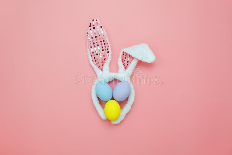 Top view aerial image of decoration & symbol Happy Easter holiday. Background concept.Flat lay accessory costume bunny ear & paint eggs on modern beautiful pink stock images