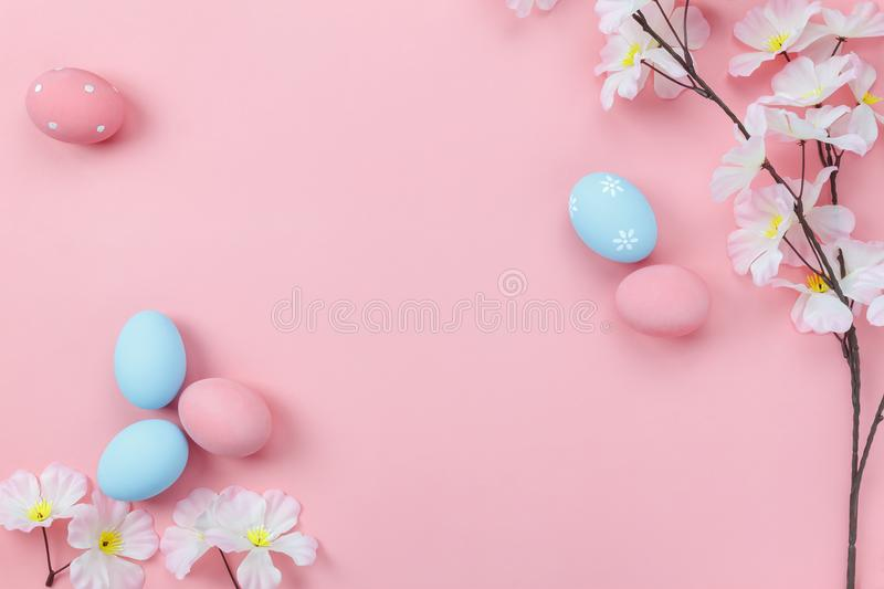 Top view aerial image of decoration & symbol Happy Easter holiday. Background concept.Flat lay accessory bunny eggs & floral on modern beautiful pink paper at royalty free stock images
