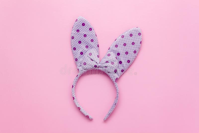 Top view aerial image of decorations & symbol Happy Easter. Holiday background concept.Flat lay accessory costume for festive purple bunny ear on modern grunge royalty free stock photos