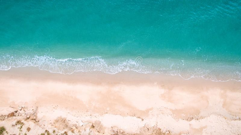 Top view aerial image from drone of an stunning beautiful sea landscape beach with turquoise water. With copy space for your text.Beautiful Sand beach with stock images