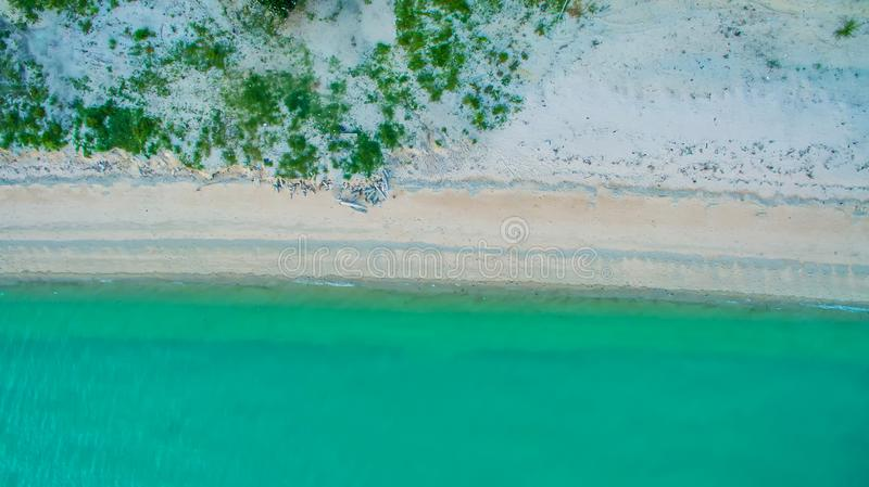 Top view aerial image from drone of an stunning beautiful sea landscape beach with turquoise water. With copy space for your text.Beautiful Sand beach with stock photography