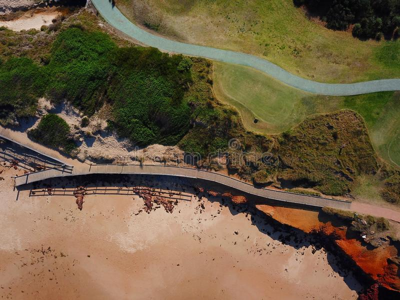 Top view aerial photo of wooden pathways at Dee Why beach. Top view aerial photo of beauty nature landscape with wooden pathways at Dee Why beach in winter day stock images