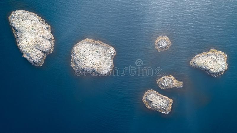 Top view aerial photo from flying drone of many small islands, ocean with sunny rays and turquoise water with copy space for your. Advertising, vacation concept stock photo