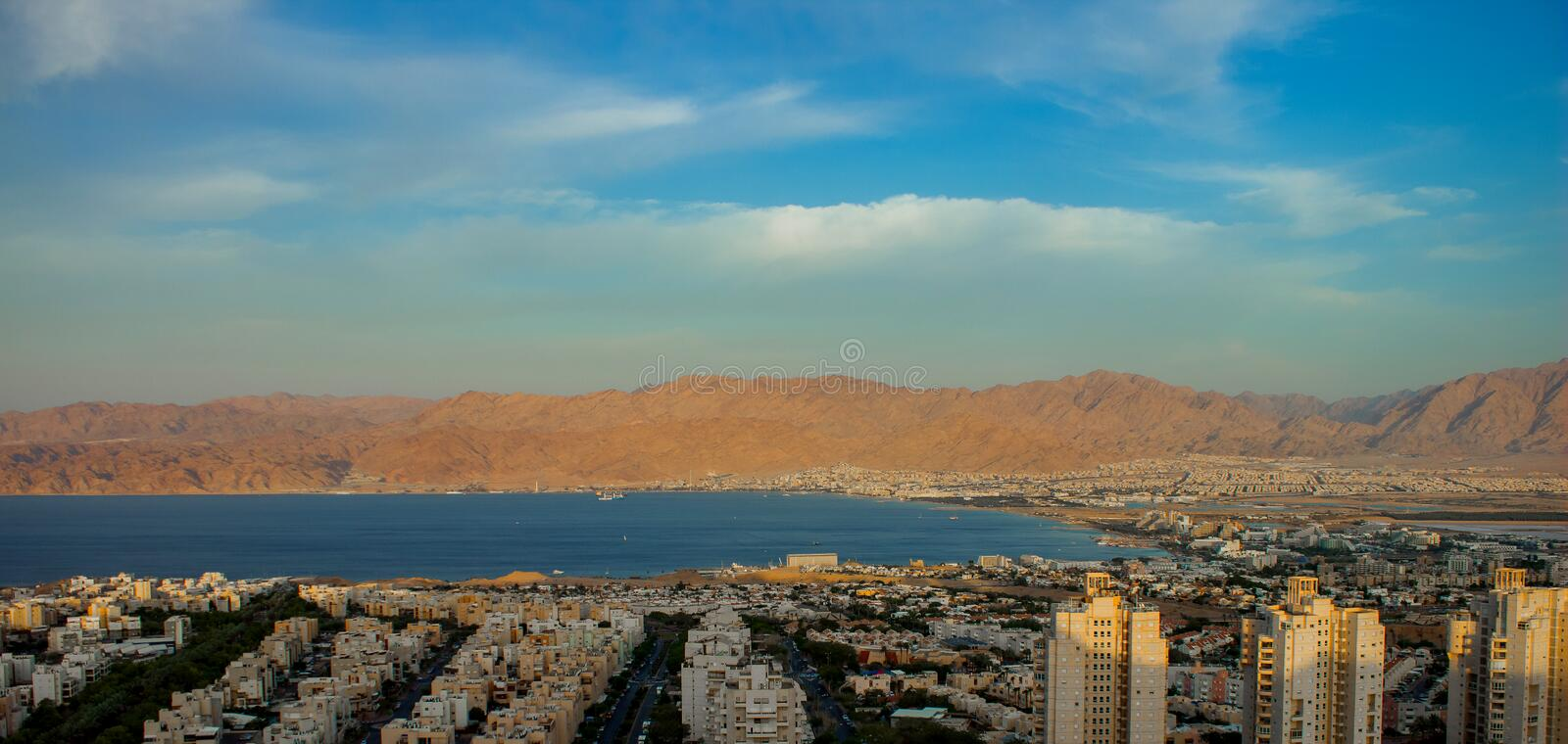 Top view aerial photography of the most south Israeli city Eilat near Gulf of Aqaba Red sea bay with Jordanian desert and mountain. S royalty free stock photo