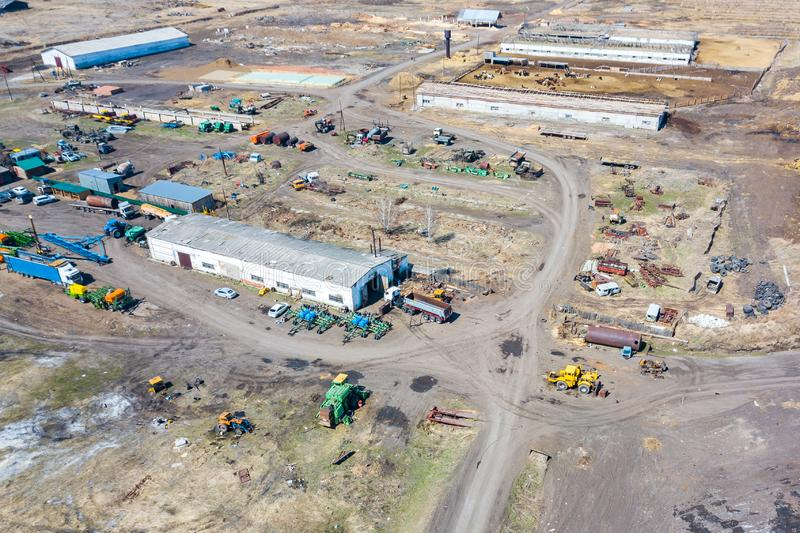 Top view on agricultural machinery near the hangar in the village for planting and harvesting. Tractor, plow, combine fuel truck. And truck in green and blue royalty free stock photos