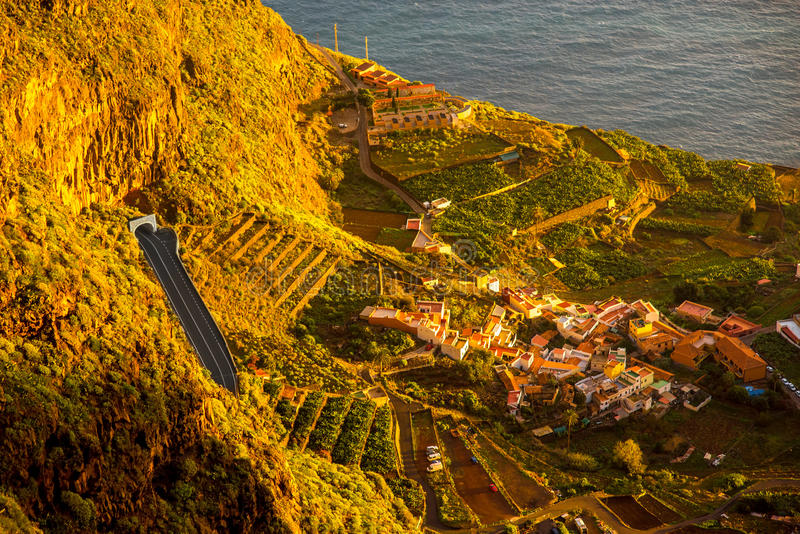Top view on Agulo coastal village in Spain. Top view from Mirador de Abrante on Agulo coastal village on La Gomera island on the sunrise in Spain stock photo
