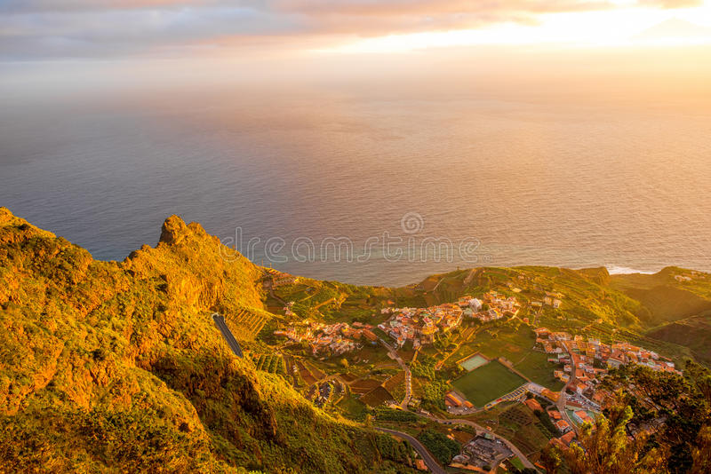 Top view on Agulo coastal village in Spain. Top view from Mirador de Abrante on Agulo coastal village on La Gomera island on the sunrise in Spain stock photos