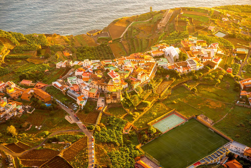 Top view on Agulo coastal village in Spain. Top view from Mirador de Abrante on Agulo coastal village on La Gomera island on the sunrise in Spain stock photo