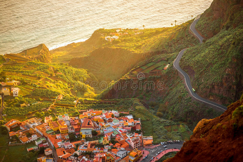 Top view on Agulo coastal village in Spain. Top view from Mirador de Abrante on Agulo coastal village on La Gomera island on the sunrise in Spain royalty free stock photos